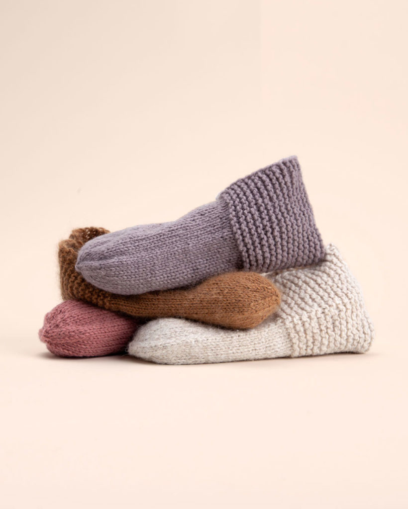 a pile of simple house slippers